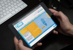 Image of Cim Logic website on a hand held tablet