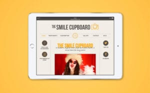 Image of Smile Cupboard website on an Ipad screen